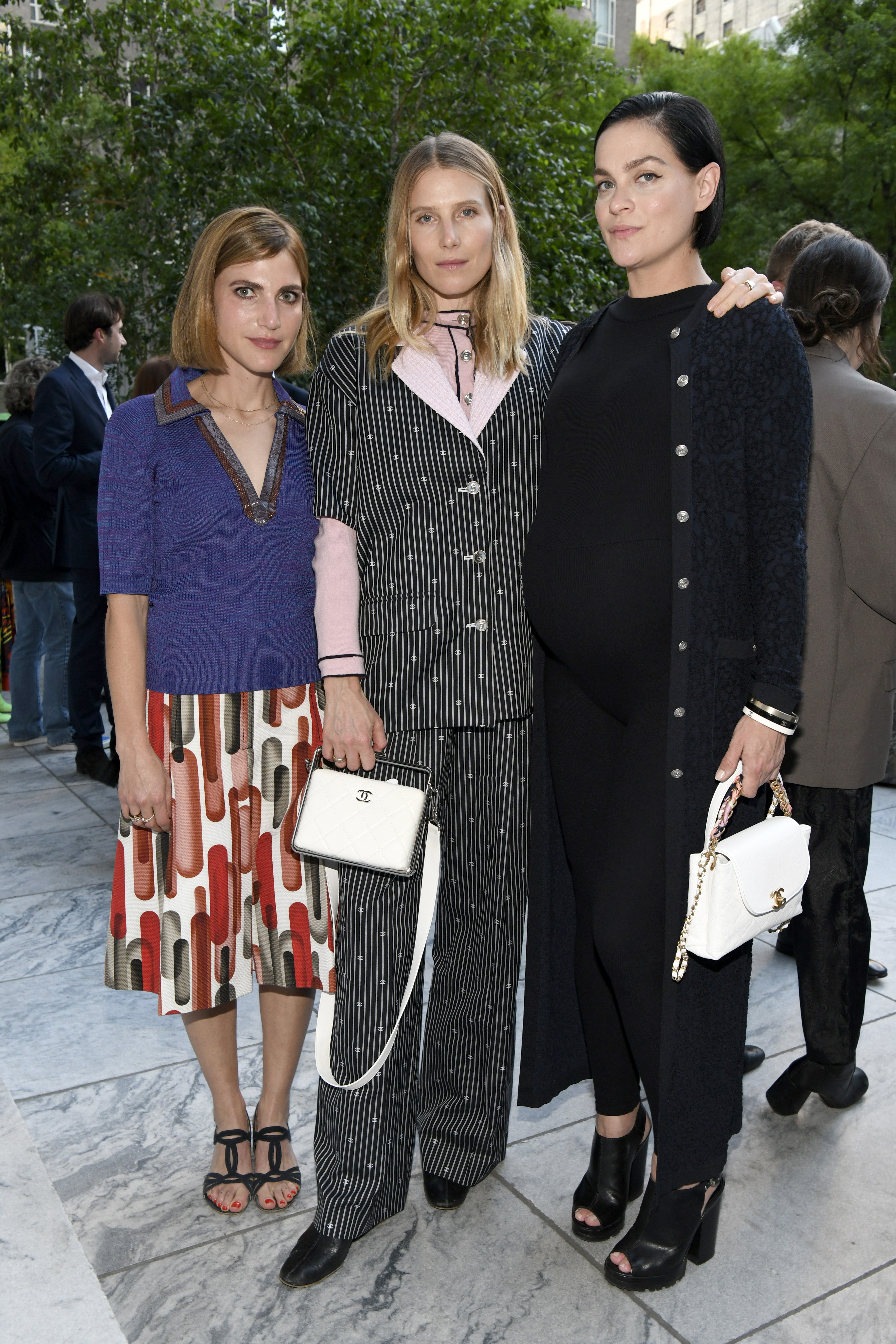 """NEW YORK, NEW YORK - JUNE 17: (L-R) Sophie Kargman, Dree Hemingway, and Leigh Lezark, wearing CHANEL, attend the CHANEL and Tribeca Festival Screening of Julian Schnabel's Remastered Film, """"Basquiat"""" on June 17, 2021 in New York City. (Photo by Clint Spaulding/WireImage)"""