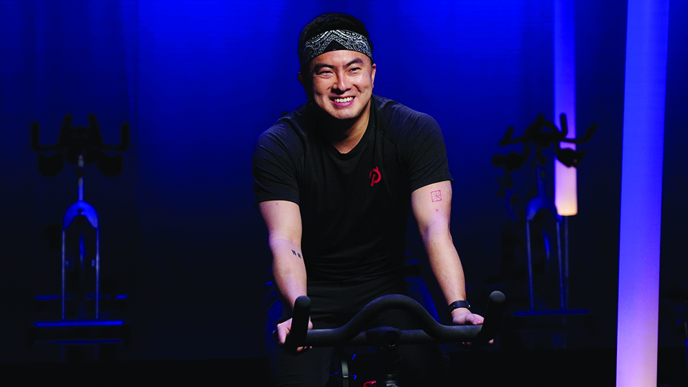 """SATURDAY NIGHT LIVE -- """"Regina King"""" Episode 1797 -- Pictured: Bowen Yang during the """"New Exercise Bike"""" sketch on Saturday, February 13, 2021 -- (Photo by: Rosalind O'Connor/NBC)"""