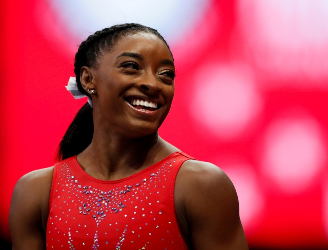 Dominique Moceanu, Michael Phelps, Michelle Obama Send Support To Simone Biles: 'We Are Proud of You'.jpg