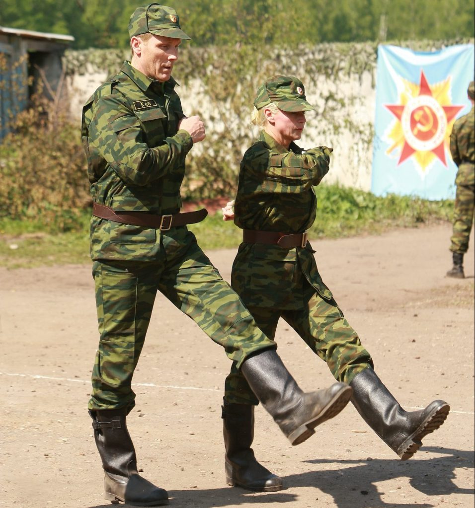 """""""That is Studly"""" -- Separated couple Ken and Tina perform Detour A """"M.P."""" in which they must don traditional military uniforms and learn a traditional Russian military march at an outdoors barracks in the Moscow area in order to receive their next clue, on THE AMAZING RACE 13, Sunday, Nov. 23 (8:00-9:00 PM, ET/PT) on the CBS Television Network. Photo: Monty Brinton/CBS ©2008 CBS Broadcasting Inc. All Rights Reserved."""