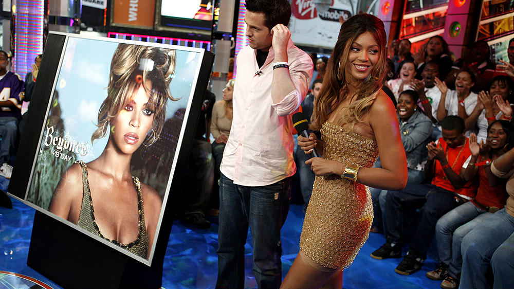 """Beyonce Knowles, right, and VJ Damien Fahey appear onstage during MTV's """"Total Request Live"""" at the MTV Times Square Studios Tuesday, Sept. 5, 2006 in New York. Beyonce's latest album """"B'Day"""" hit stores Tuesday, Sept. 5. (AP Photo/Jason DeCrow)"""