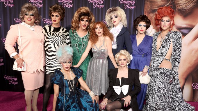 Jessica Chastain poses with drag queens