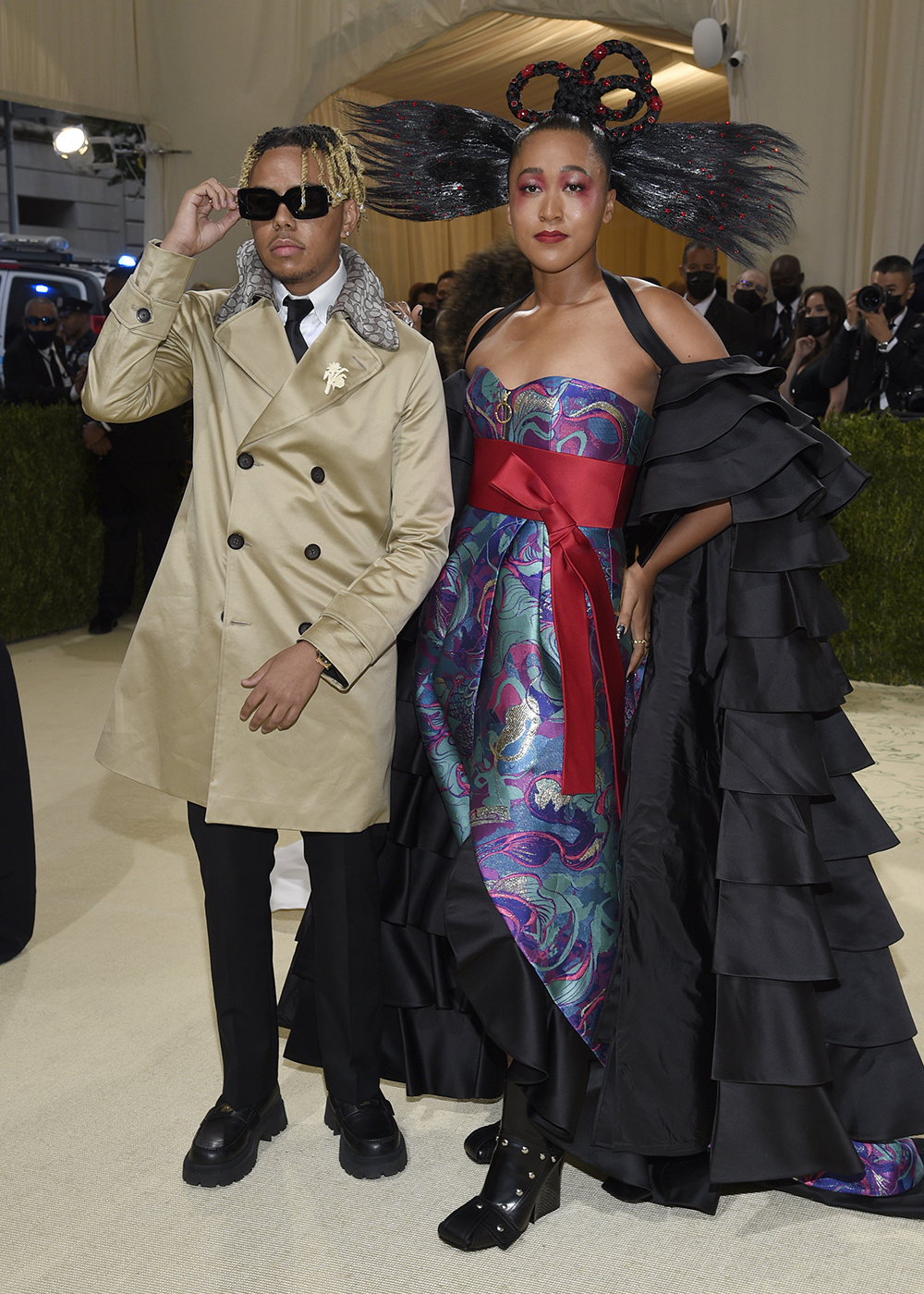 """Cordae Dunston, left, and Naomi Osaka attend The Metropolitan Museum of Art's Costume Institute benefit gala celebrating the opening of the """"In America: A Lexicon of Fashion"""" exhibition on Monday, Sept. 13, 2021, in New York. (Photo by Evan Agostini/Invision/AP)"""