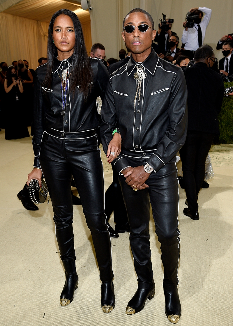 """Helen Lasichanh, left, and Pharrell Williams attend The Metropolitan Museum of Art's Costume Institute benefit gala celebrating the opening of the """"In America: A Lexicon of Fashion"""" exhibition on Monday, Sept. 13, 2021, in New York. (Photo by Evan Agostini/Invision/AP)"""