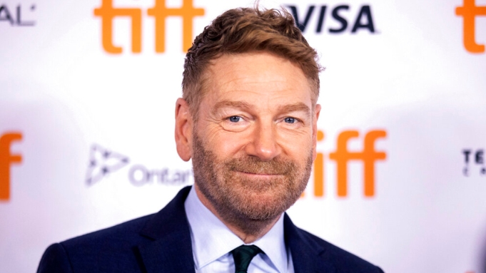 Director Kenneth Branagh walks the red