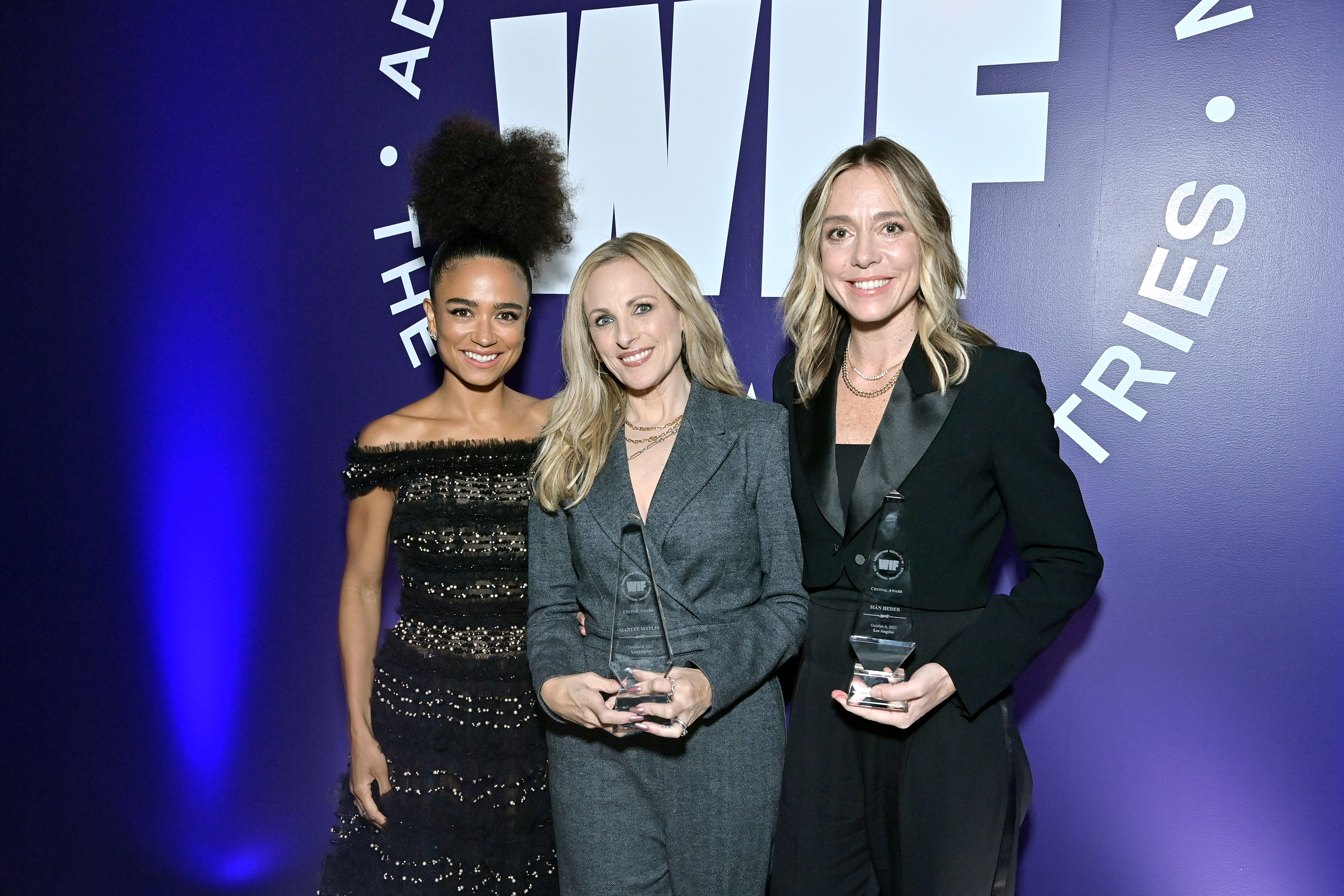LOS ANGELES, CALIFORNIA - OCTOBER 06: (L-R) Lauren Ridloff, and Crystal Award Honorees Marlee Matlin and Siân Heder, wearing Max Mara, pose with their awards during the Women in Film Honors: Trailblazers of the New Normal sponsored by Max Mara, ShivHans Pictures, and Lexus at the Academy Museum of Motion Pictures on October 06, 2021 in Los Angeles, California. (Photo by Stefanie Keenan/Getty Images for Women In Film (WIF))
